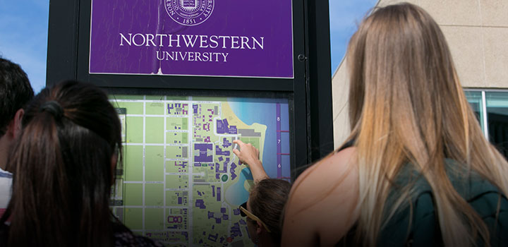 students looking at campus map